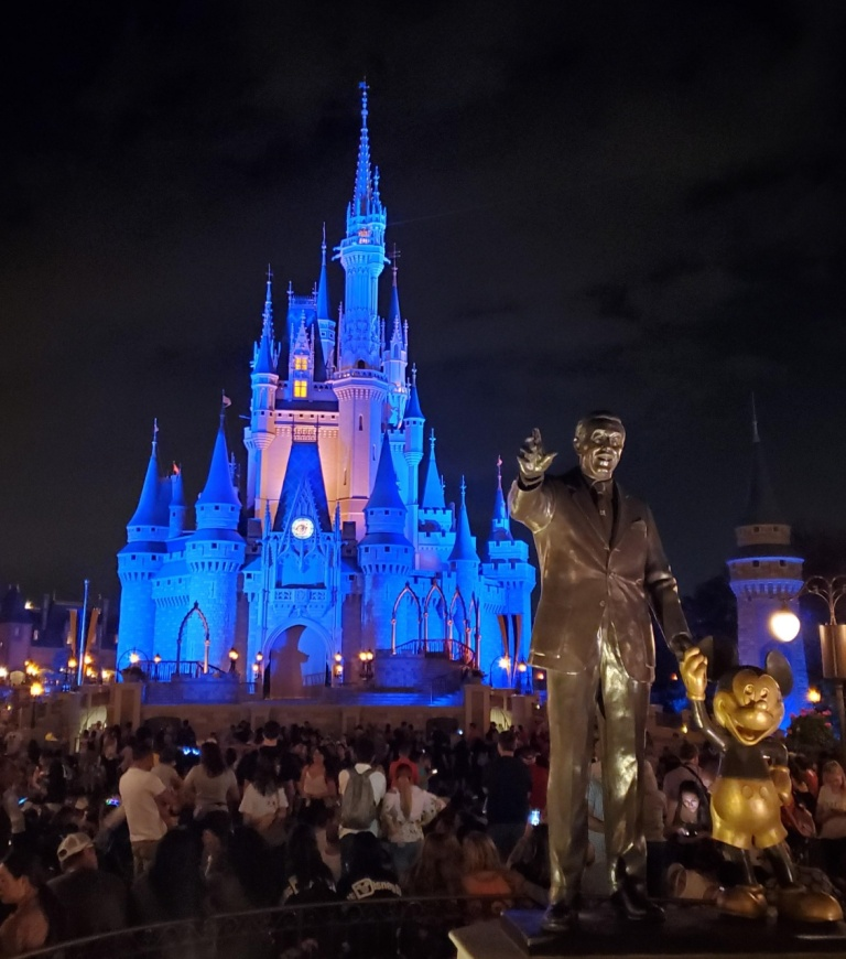 Cinderella's Castle at night with the Partners statue in the foreground