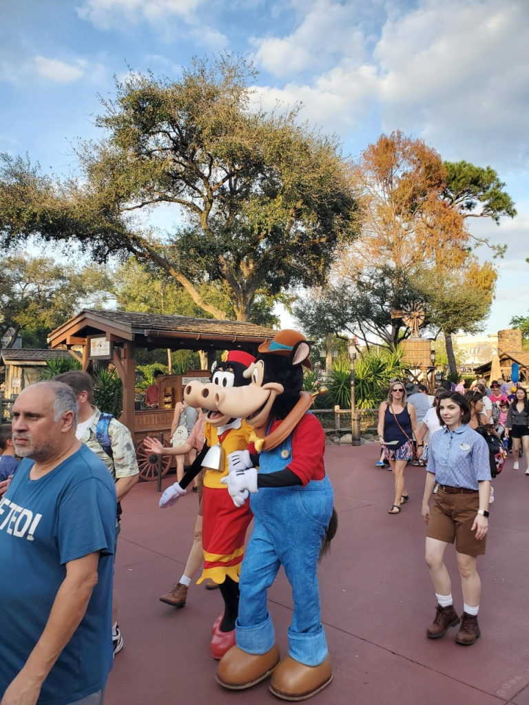 Horace Horsecollar and Clarabelle Cow walking through Frontierland