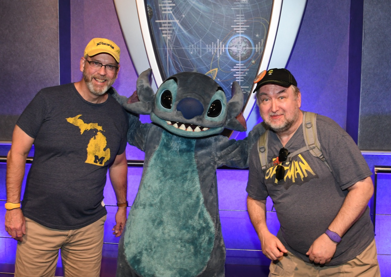 Having fun posing with Stitch in Tomorrowland.