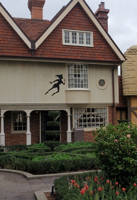 Peter Pan on the wall of a United Kingdom pavilion building.